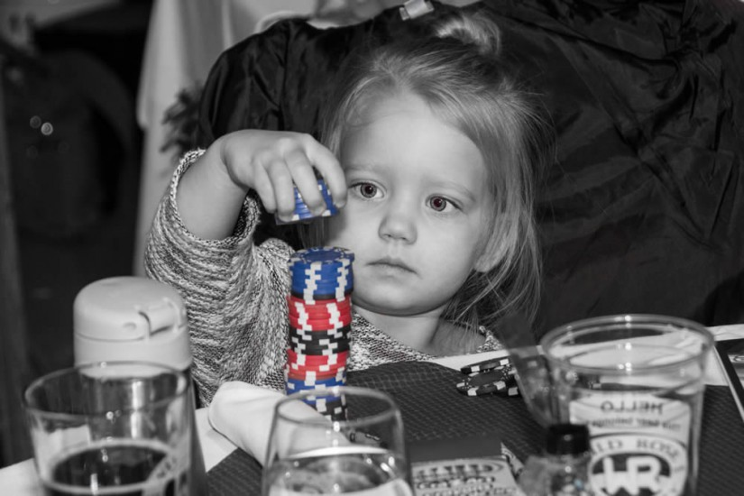 Candid shot of young girl stacking poker chips