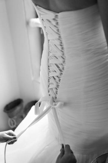 Jamie's sister fastening her dress
